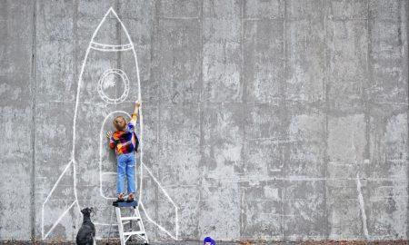 20160505175639-self-motivated-boy-drawing-rocket-chalk-dog