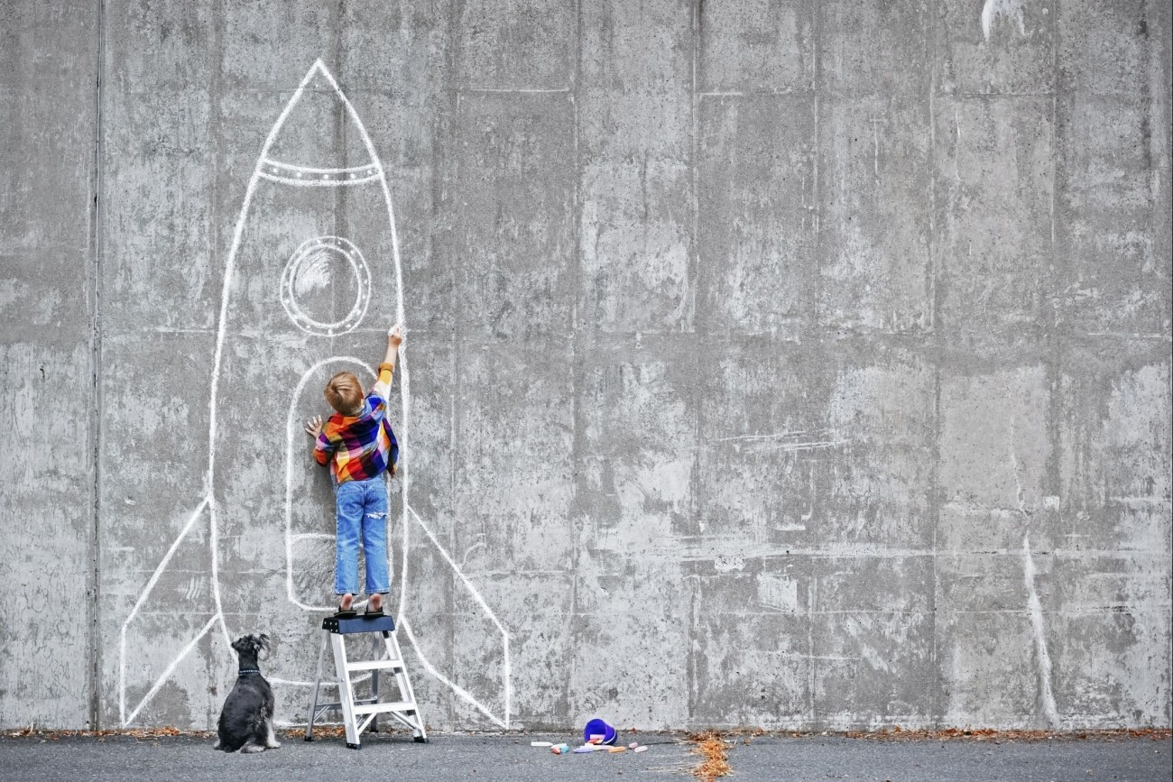 20160505175639-self-motivated-boy-drawing-rocket-chalk-dog